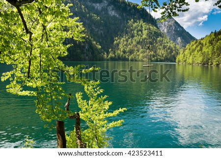 Rope swing over the turquoise water of Lake Koenigssee
