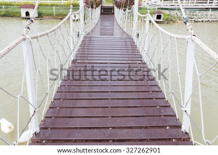 Rope walkway through the river - stock photo