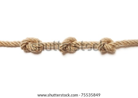 Rope with a three tied knots - stock photo