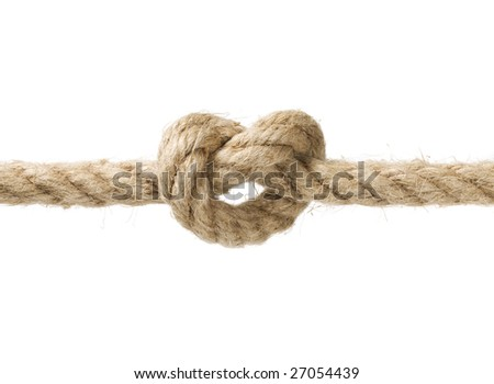Rope with knot close up. Isolated on white background.