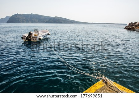 Roped Boat n the port of Oia (Santorini) - stock photo