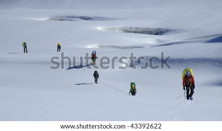 Roped team moving through a glacier, Tien Shan