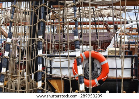 Ropes and rigging on an old sailing vessel in the harbor of Kiel, Germany - stock photo