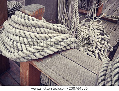 Ropes around cleat on vintage yacht - stock photo