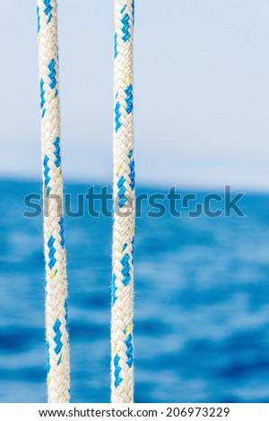 Ropes closeup on sailing - stock photo