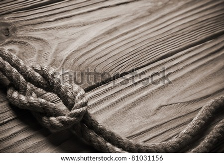 Ropes on a wooden background - stock photo
