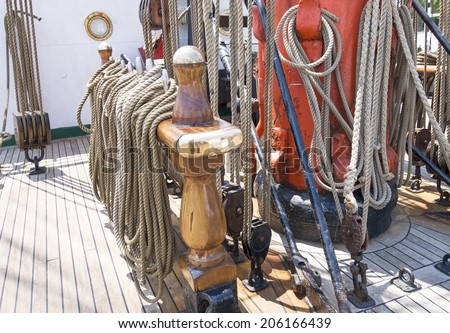 Ropes on deck of an old tall-ship - stock photo