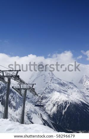 Ropeway at ski resort. Caucasus. Dombay - stock photo