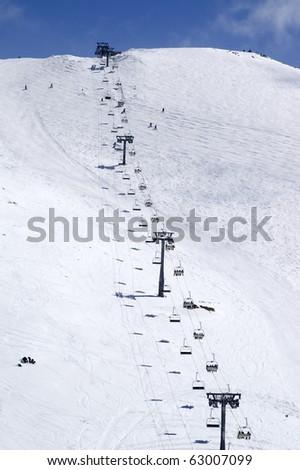 Ropeway at ski resort. Caucasus Mountains,  Dombay. - stock photo