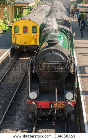 ROPLEY, UK - 19 SEPTEMBER: Vintage steam and diesel locomotives at the Mid-Hants Watercress Railway station of Ropley, UK on 19 September, 2015 - stock photo