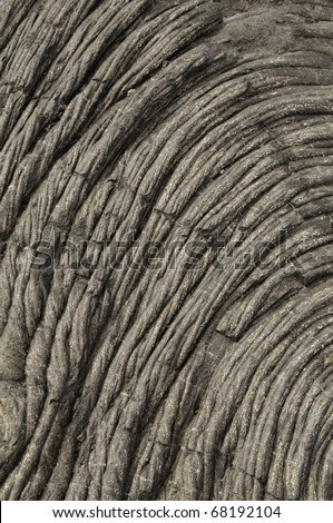 Ropy texture of cooled pahoehoe lava in Hawaii Volcanoes National Park - stock photo