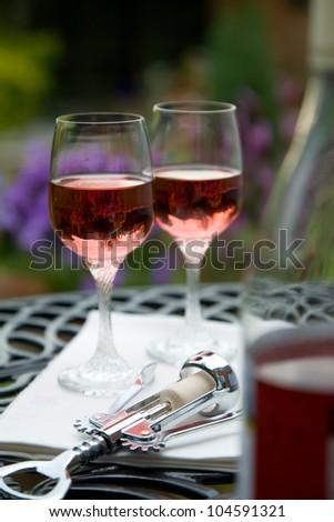 Ros�© on garden table - stock photo