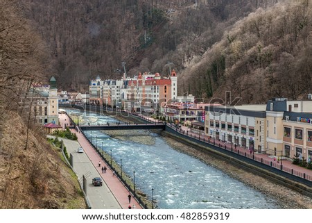 "Rosa Khutor, Russia - March 16, 2016: view of the river and a ski lift ""Olympia"" on of world class ski resort of Rosa Khutor, which was built for the Olympic Games 2014"
