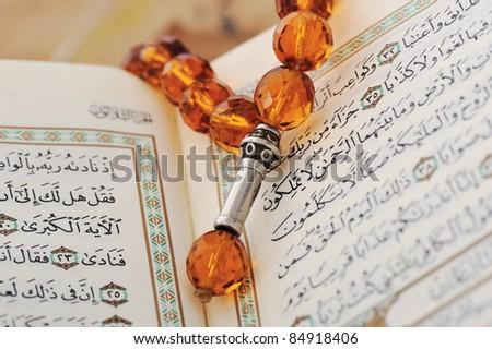 Rosary and Qoran - stock photo