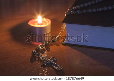 Rosary beads and a holy bible - stock photo