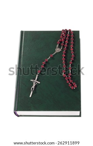 rosary beads on Bible - stock photo