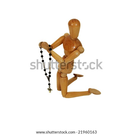 Rosary beads used for prayer in the Catholic faith, hands held together in prayer during many religious ceremonies, Wooden model representing a person - stock photo