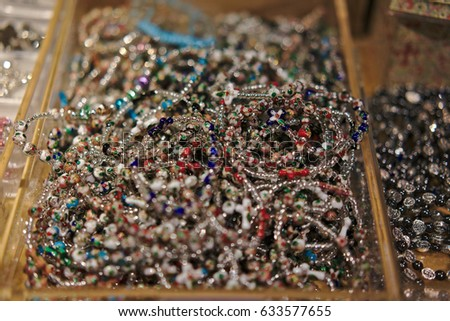 Rosary Beads used for Praying displayed for sale at the Cathedral of Saint Mary of the Flower in Florence, Italy