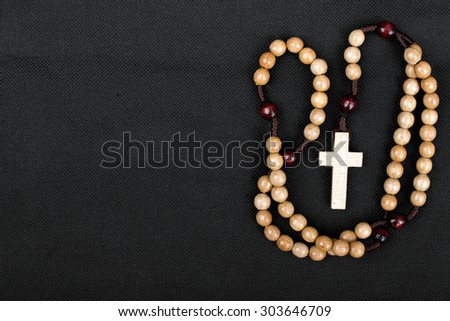 rosary on a dark background - stock photo