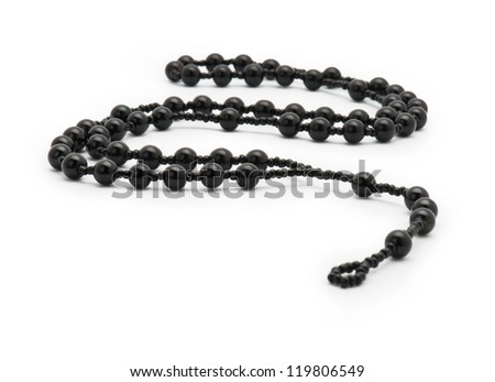 rosary on white background. - stock photo