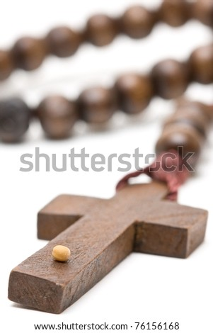 Rosary with mustard seed - symbol of faith - stock photo