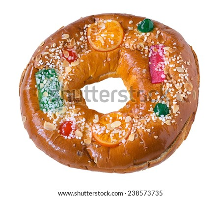 "Roscon de reyes (Three kings cake). It is a traditional Spanish holiday dessert served the morning of ??""Reyes"" (King'??s Day), or Epiphany (January 6th) - stock photo"