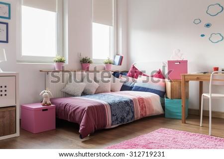 Rose accessories in cozy teen girl room - stock photo
