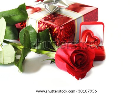Rose and gifts laying on white background photo with shadows