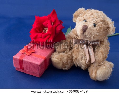 Rose and present gift on blue background/ Valentines day background - stock photo