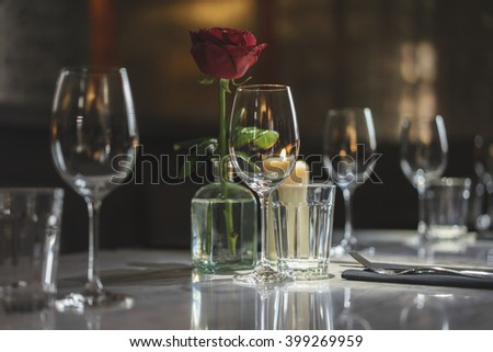 Rose and vine glasses on restaurant table