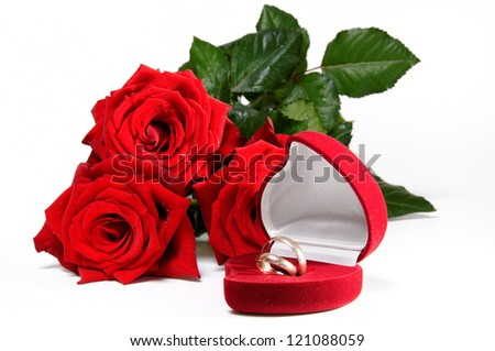 Rose and wedding rings - stock photo