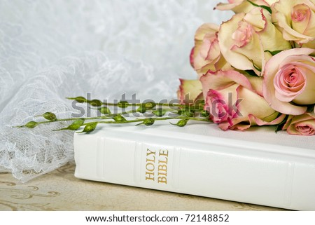 rose bouquet on white bible