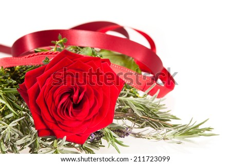 Rose bouquet with herbs - stock photo