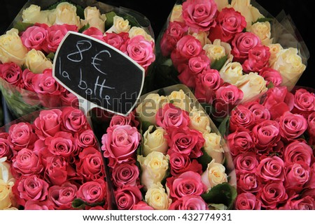 Rose bouquets in various colors at the flower market in Aix en Provence (tags: price in euro a bunch) - stock photo