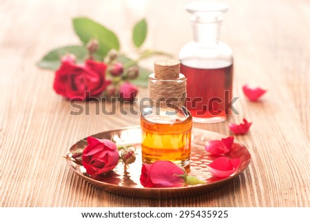 Rose essential oil and flowers roses. Spa, body care, aromatherapy. horizontal - stock photo