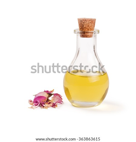 Rose flower petals and buds with aromatherapy essential oil glass bottle isolated over white background