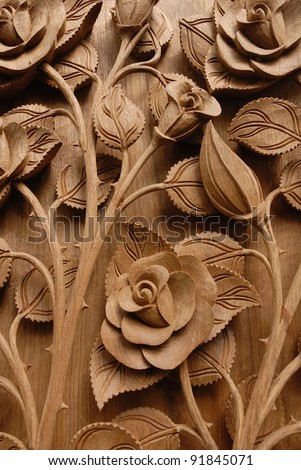 Rose Flower Thai style Teak wood carving Door in Chiangmai Thailand - stock photo