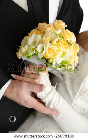 Rose flowers wedding bouquet, hands of bride and groom, traditional black and white wedding dress, on white background - stock photo