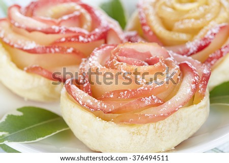 Rose from apple and puff pastry - stock photo