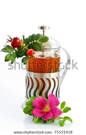rose-hip tea in the teapot, isolated on a white background