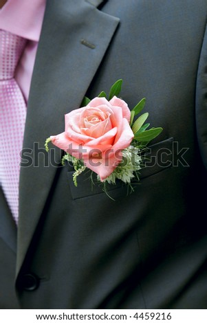 Rose in a lapel of a man's jacket - stock photo