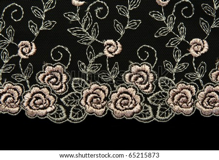 Rose lace with pattern in the manner of flower on black background - stock photo