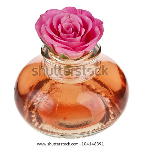 Rose oil  in bottle isolated on white - stock photo