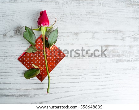 rose on wooden background. Valentines day background
