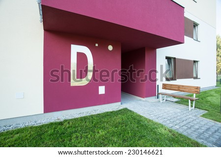 Rose painted entrance to new apartment house - stock photo