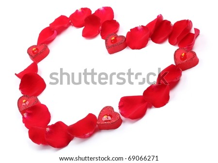 Rose petals and candles forming heart shape on white background.