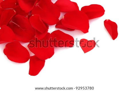 Rose petals and small paper heart for Valentines Day