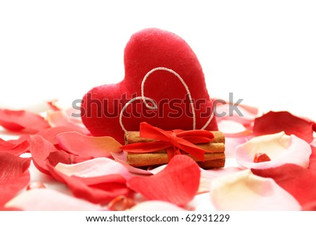 rose petals, heart, cinnamon on a white background - stock photo