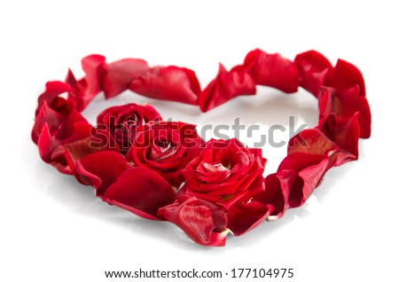 Rose petals in a shape of a heart - stock photo