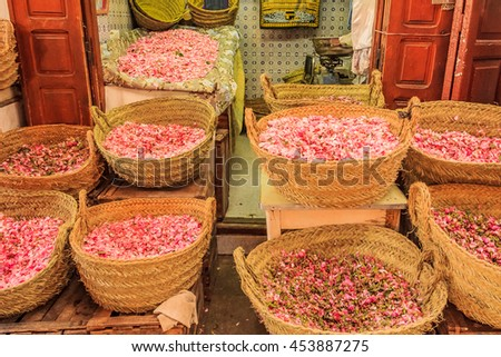 Rose petals in baskets at the souk, Moroccan market in the medina in Fes